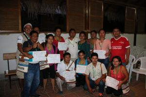 Agua Blanca community members pose with their certificates of participation